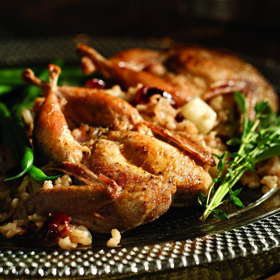 Quail with Ginger-Cranberry Pilaf EatingWell Test Kitchen
