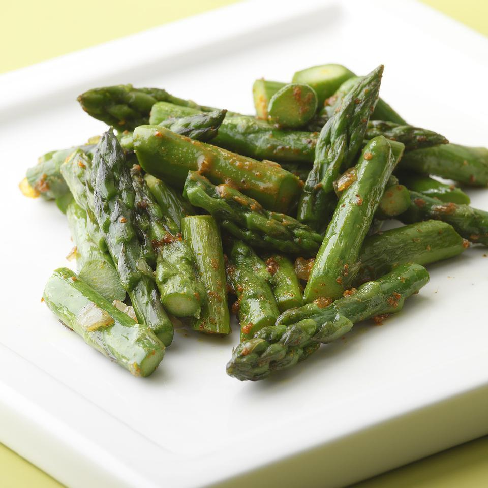 Asparagus with Curry Butter EatingWell Test Kitchen