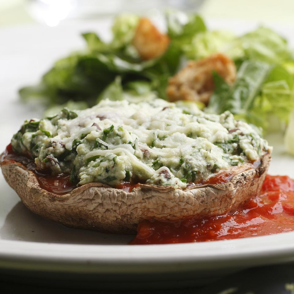 Here we take the elements of a vegetarian lasagna filling—ricotta, spinach and Parmesan cheese—and nestle them into roasted portobello mushroom caps. The recipe works best with very large portobello caps; if you can only find smaller ones, buy one or two extra and divide the filling among all the caps. Serve with a tossed salad and a whole-wheat dinner roll or spaghetti tossed with marinara sauce.