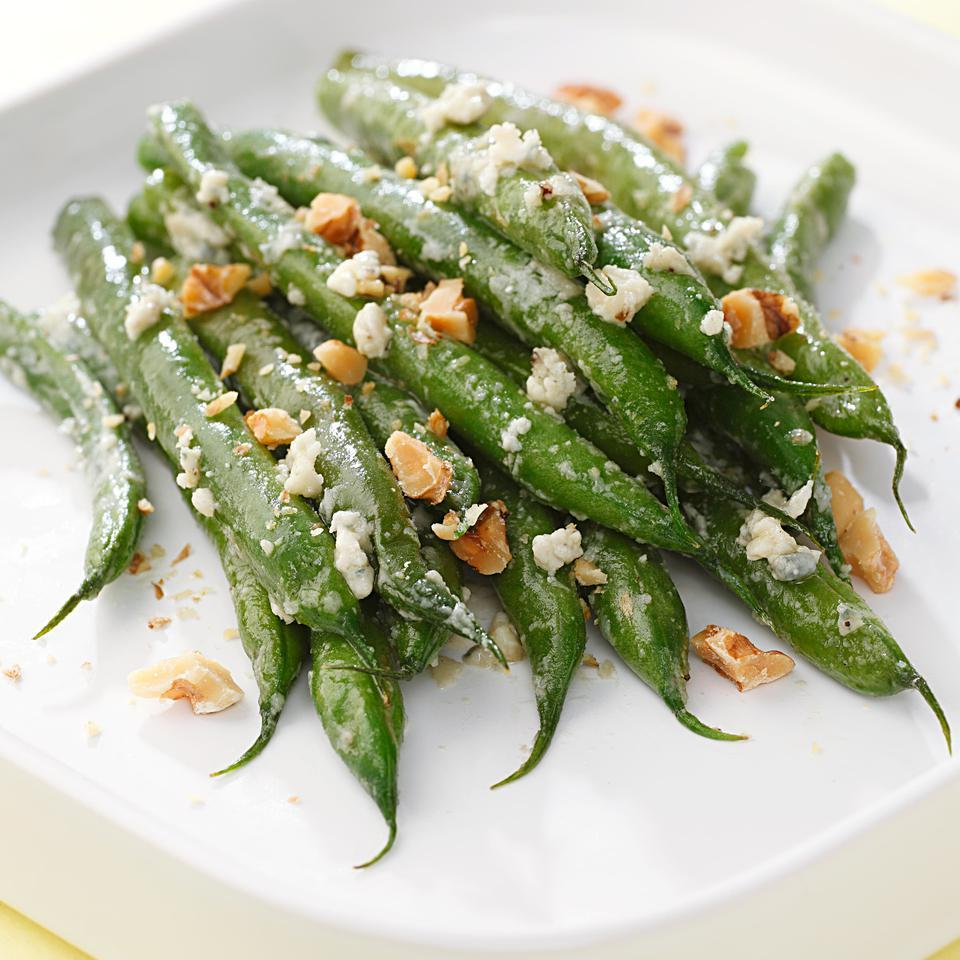 Tender-crisp green beans tossed with creamy blue cheese and topped with toasted walnuts make for the perfect Thanksgiving side dish.