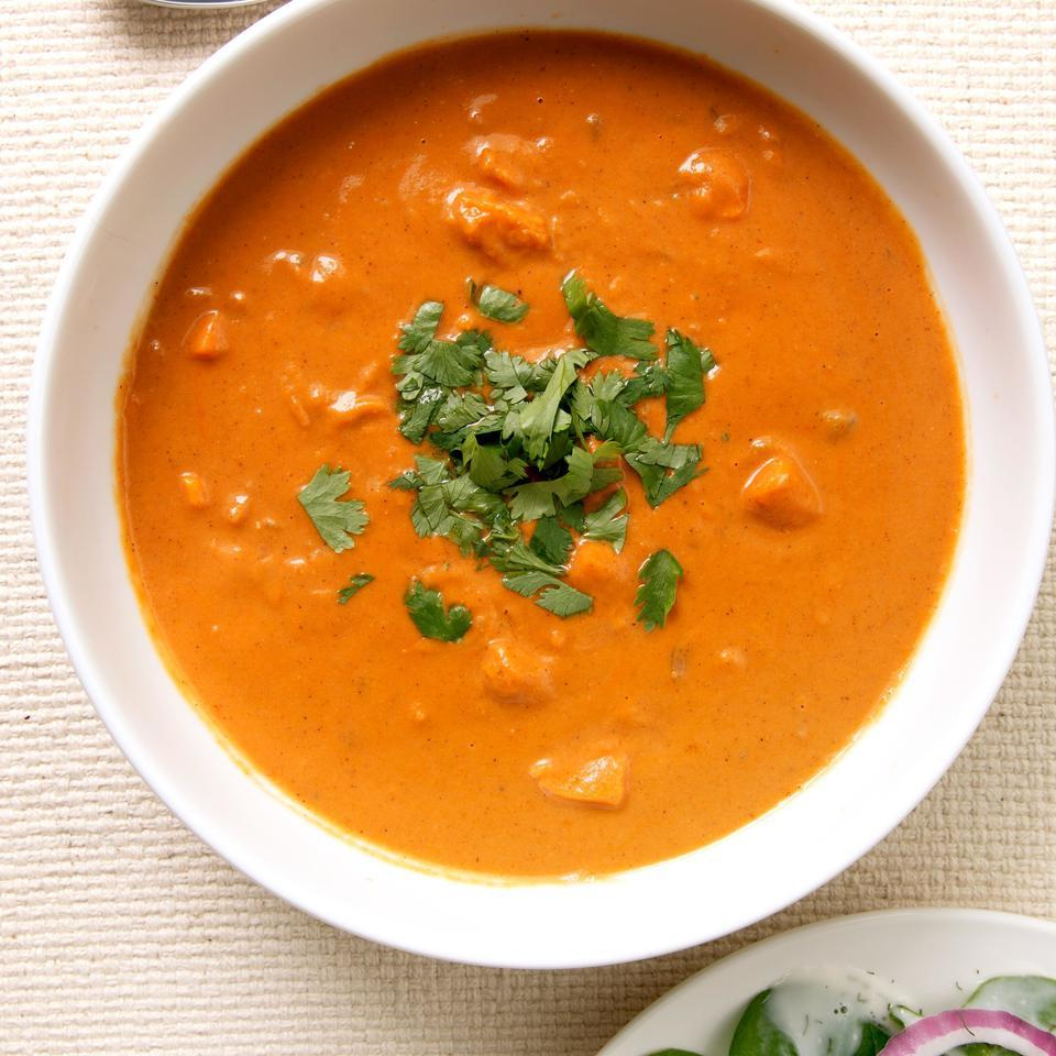 This satisfying vegetarian sweet potato soup is inspired by the flavors of West African peanut soup. We like the added zip of hot green chiles, but they can sometimes be very spicy. It's best to take a small bite first and add them to taste. Try chopped peanuts and scallions for a different garnish. Serve with a mixed green salad with vinaigrette.