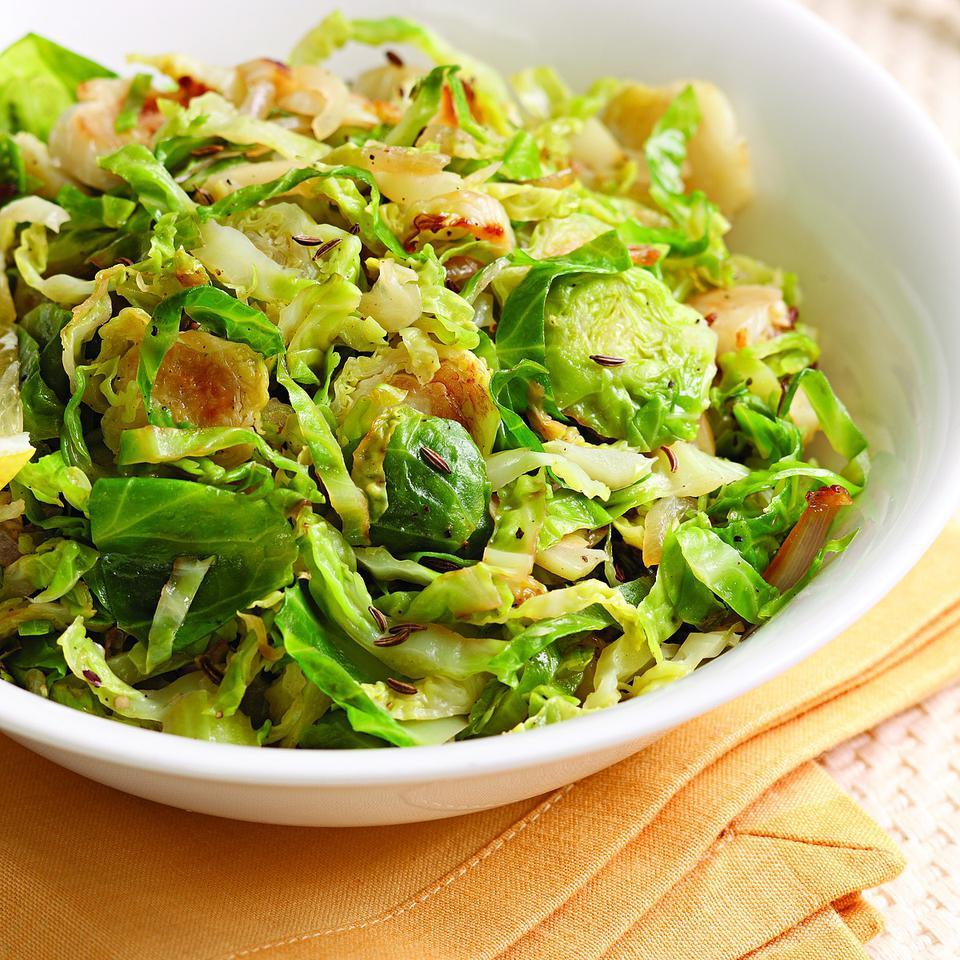 Thinly sliced Brussels sprouts cook quickly and soak up whatever flavors you add to them—in this case, lemon and caraway.
