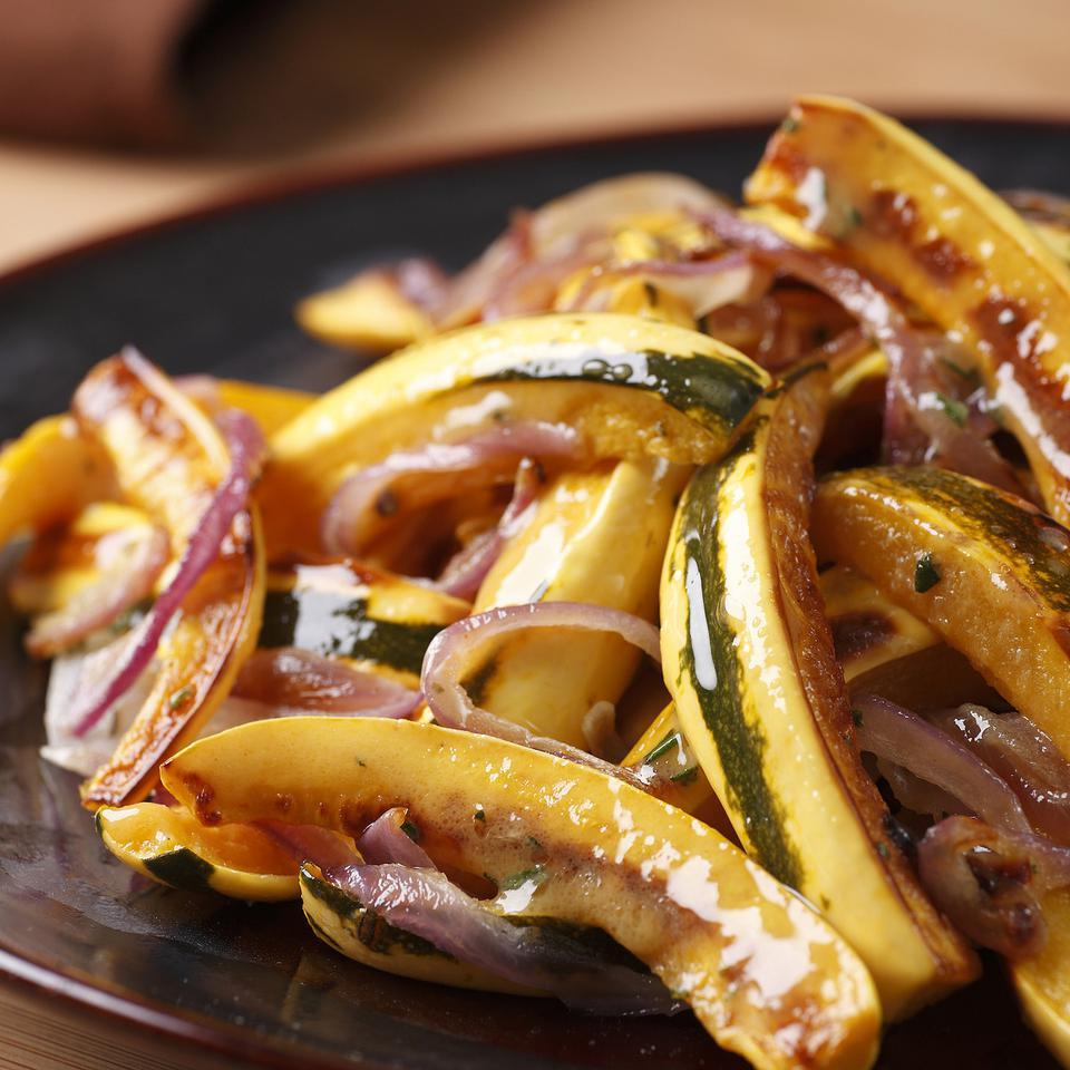 Roasting intensifies delicata squash's flavor. Seasoned with rosemary and maple, this recipe's great with pork or turkey.