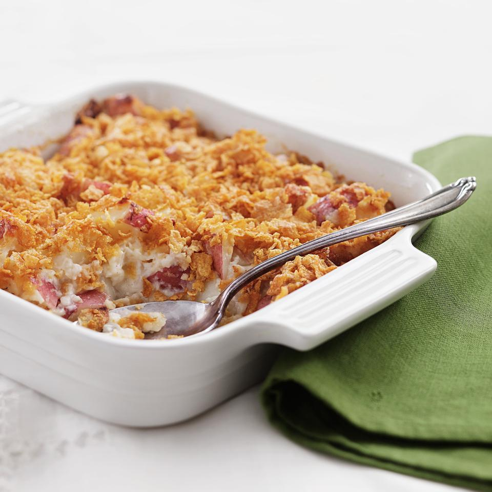The original version of this cheesy potato casserole stars canned soup, full-fat sour cream, a stick of butter and a crust of crushed potato chips. We lightened it considerably by using a homemade white sauce instead of canned soup and swapping nonfat Greek yogurt for the sour cream. Crushed corn flakes replace the potato chips. All in all, we slashed 200 calories, 25 grams of fat (12 grams saturated) and 170 milligrams of sodium per serving. Dig in!