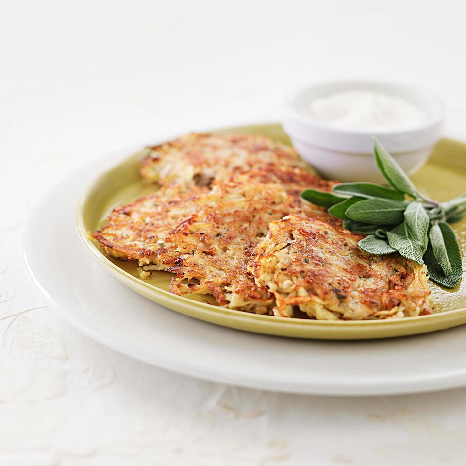 It's easy to make crispy latkes for Hanukkah without oodles of oil. Adding shredded pears to the traditional potato mixture gives the latkes a hint of sweetness; a touch of fresh sage provides an herbal note that goes well with most holiday meals. Serve the latkes topped with a dollop of low-fat sour cream or enjoy them plain.