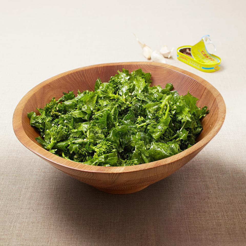 In this broccoli rabe salad recipe, the dressing is massaged into the leaves and florets, virtually eliminating its bitter undertones.