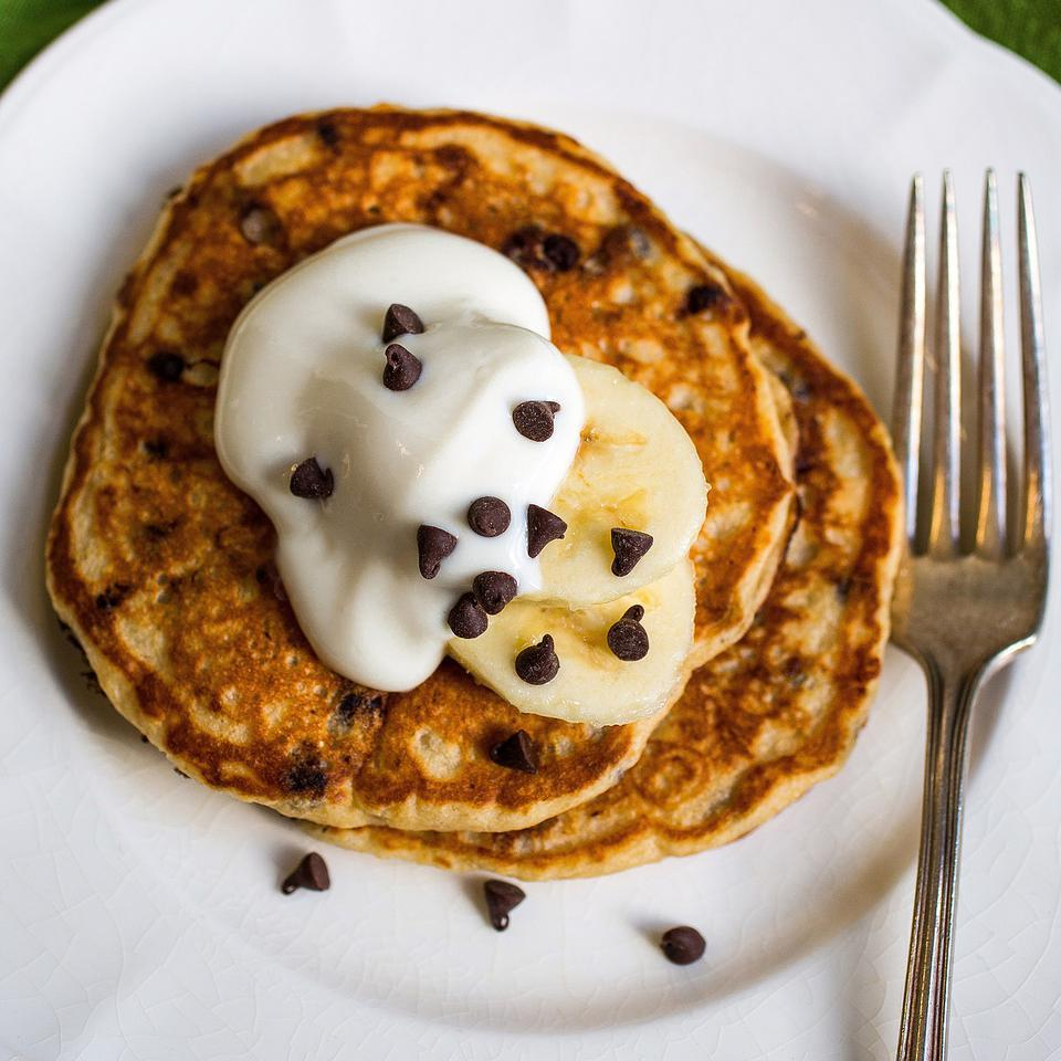 This healthy whole-grain buttermilk pancake recipe adds mini-chocolate chips and mashed banana to the 100% whole-wheat flour base. If you want to experiment with different types of whole grains, replace up to ½ cup of the whole-wheat flour with cornmeal, oats and/or buckwheat flour. Or add extra fiber and healthy omega-3 fats by adding up to 3 tablespoons of ground flaxseed or chia seeds.