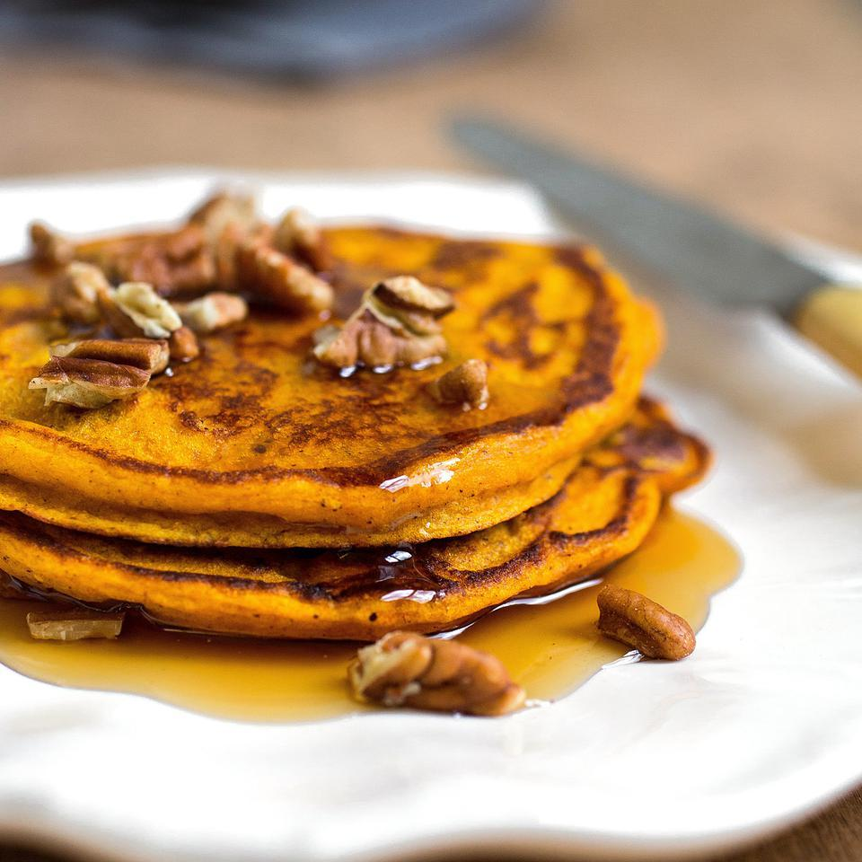 This healthy whole-grain pumpkin pancake recipe produces fluffy cakes with a beautiful orange hue from pureed pumpkin and light crunch from toasted pecans. If you want to experiment with different types of whole grains, replace up to ½ cup of the whole-wheat flour with cornmeal, oats and/or buckwheat flour. Or add extra fiber and omega-3s by adding up to 3 tablespoons of ground flaxseed or chia seeds.