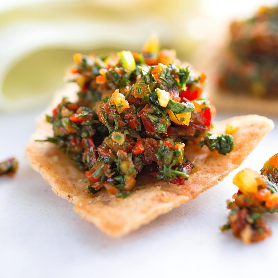 The combination of sweet and hot peppers, garlic and herbs in this salsa recipe makes this the perfect condiment to have in your fridge. Adjika, a salsa-like condiment of both Georgian and Abkhazian origins, typically accompanies grilled meat or vegetables. Or you can eat this salsa with tortilla chips straight from the bowl.