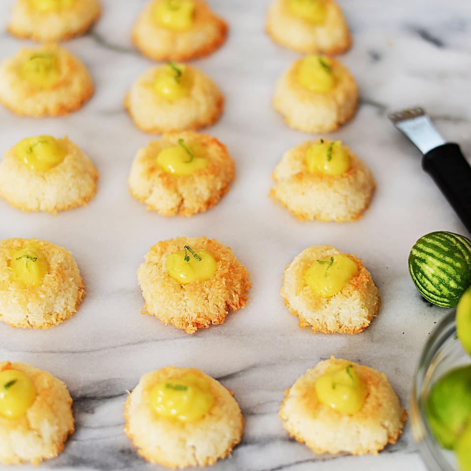 In this healthy coconut macaroon recipe, Key lime curd brightens the center of a lightly sweetened coconut cookie. If you can't find ripe Key limes, you can substitute bottled Key lime juice, which is widely available, or try another citrus flavor like more traditional Persian limes, lemons or even bright blood oranges that will produce a coral-colored curd.