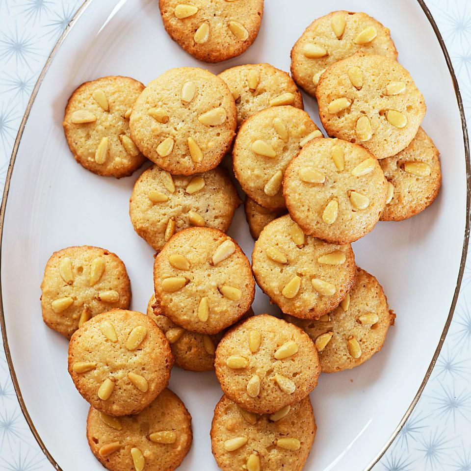 This crispy-on-the-bottom-and-chewy-on-the-inside gluten-free cookie recipe is a twist on a traditional Italian holiday treat, pignoli, or pine nut cookies. Look for almond paste—a mixture of ground almonds and sugar (available in tubes or sometimes tubs)—near other baking supplies in well-stocked supermarkets or specialty stores. Sweeter marzipan doesn't work well in these cookies.