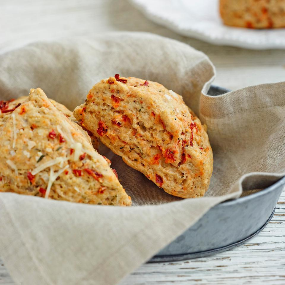No bakery degree required for this recipe: these healthy, savory sun-dried tomato-and-Asiago scones are as easy to make as a batch of muffins. White whole-wheat flour adds a boost of fiber, and just enough butter gives them great flavor and texture without going overboard on calories.