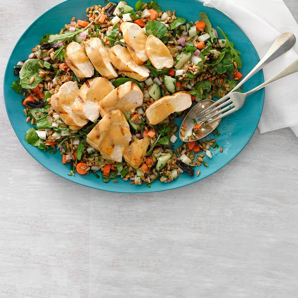 With tons of fresh herbs, arugula, olives and farro, this healthy chicken salad recipe makes a wonderful potluck platter or healthy dinner. We love the nutty flavor and quick cooking time of farro but other whole grains, such as freekeh, bulgur or couscous, are also good choices.