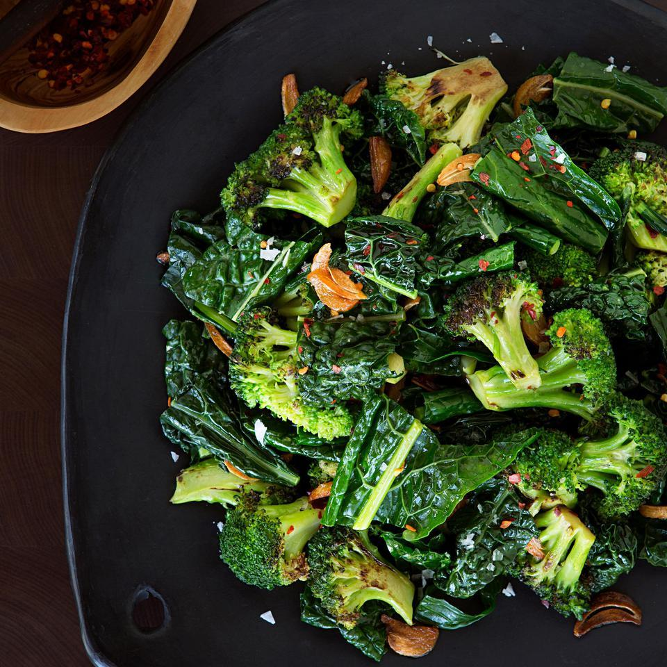 In this easy vegetable side dish, broccoli and kale are drizzled with a butter, garlic and crushed red pepper sauce. Serve this healthy recipe alongside roasted chicken, turkey or ham—or on top of your favorite whole grain, such as quinoa or farro.