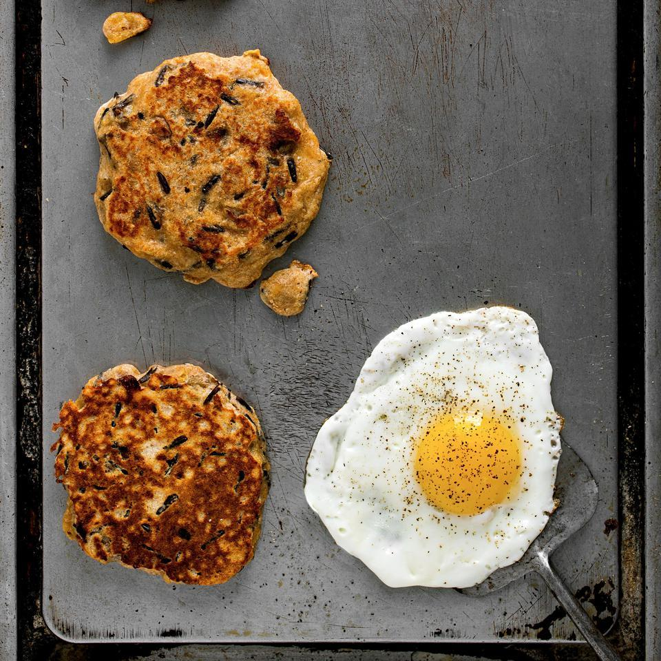 Change up your Sunday morning pancake routine with this savory pancake recipe studded with sausage crumbles and shredded sharp Cheddar. Serve these healthy pancakes with fried eggs and slices of fresh tomato.