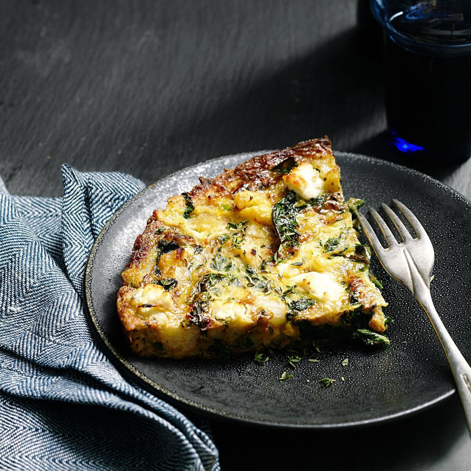 Inspired by traditional Spanish tortillas made with potatoes, this healthy frittata recipe swaps potatoes for low-carb cauliflower. Serve it along with kale (or your favorite greens) for brunch or an easy breakfast-for-dinner.