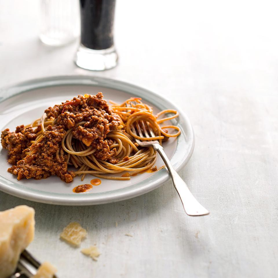 The meat sauce in this healthy pasta recipe is a Greek take on a red chili. This recipe calls for ground lamb but you could easily use ground beef or ground turkey instead.