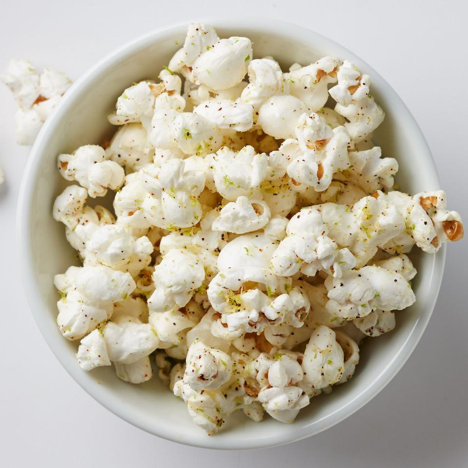 Skip the bag of microwaved popcorn and satisfy a snack craving by making your own flavored popcorn. In this healthy popcorn recipe, we use Parmesan cheese, lime zest and a hint of chili powder, but feel free to use your favorite spices. For the best flavor, opt for olive oil cooking spray to help the toppings stick to the popcorn.