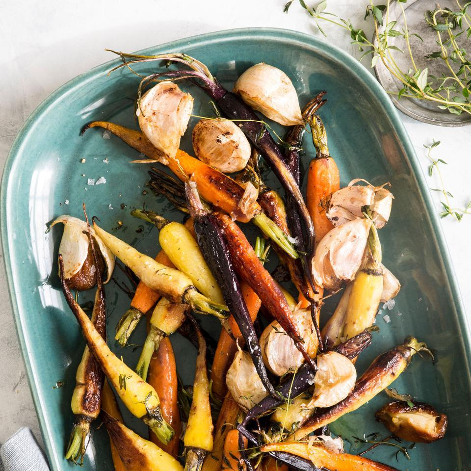 Jump-starting the browning on the stove helps bring out the carrots' sweetness in this healthy vegetable side recipe. The addition of butter, thyme, garlic and just enough lemon makes these roasted carrots extra special. Serve with grilled steak and mashed potatoes.
