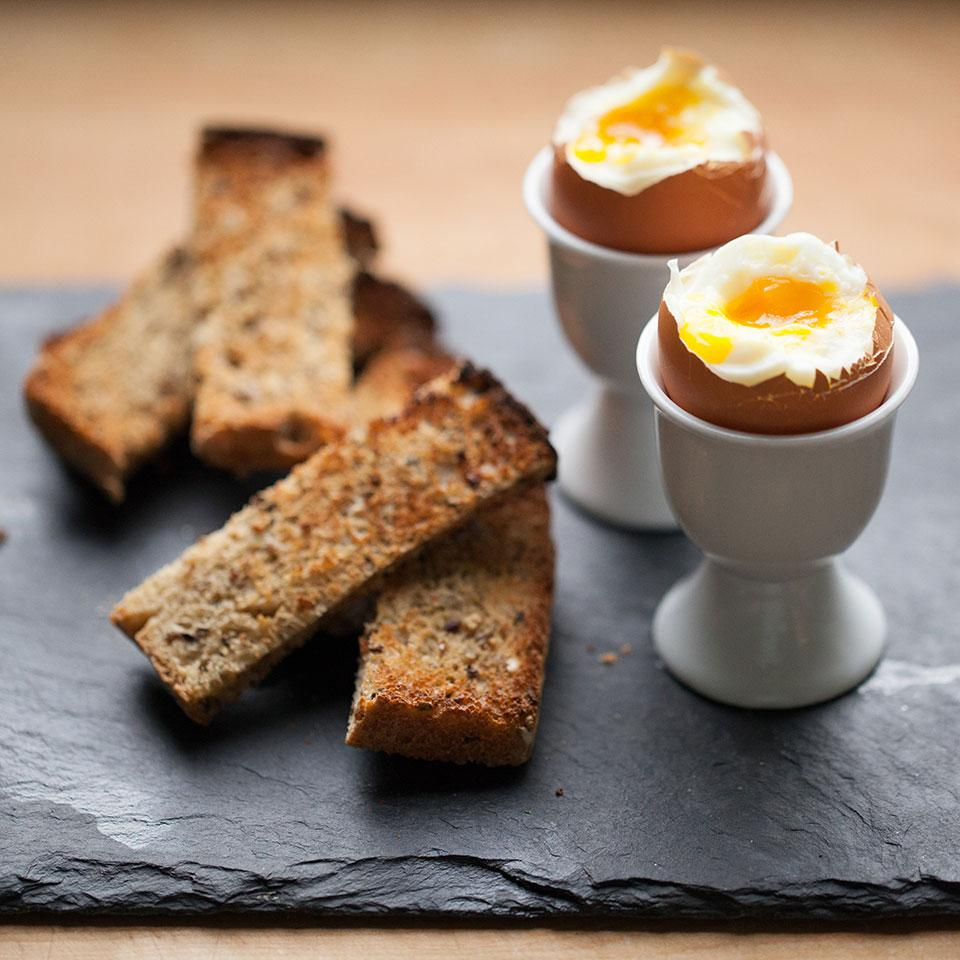 Soft-boiled eggs with toast soldiers are a classic English breakfast. Simply cut toast into strips and serve with dippy eggs for a fun, kid-friendly breakfast recipe. This recipe serves one, but can easily be multiplied to feed a crowd.