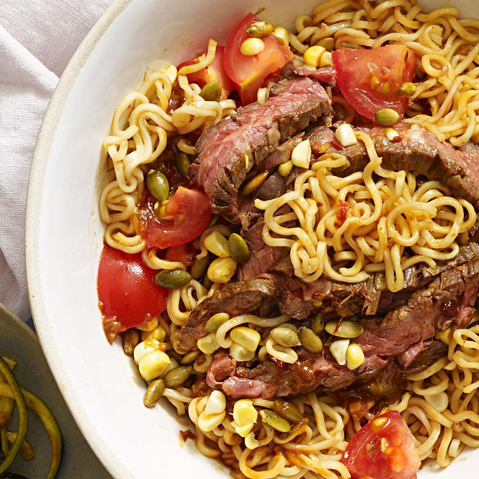"Ramen noodles are tossed with a chipotle-soy sauce in this healthy sesame noodle recipe. Be sure to rinse the noodles until they're cold, then give them a good shake in the colander until they're well drained. Are you a spiralizing pro? Swap 5 cups of raw zucchini, carrot or other veggie ""noodles"" for the cooked pasta."