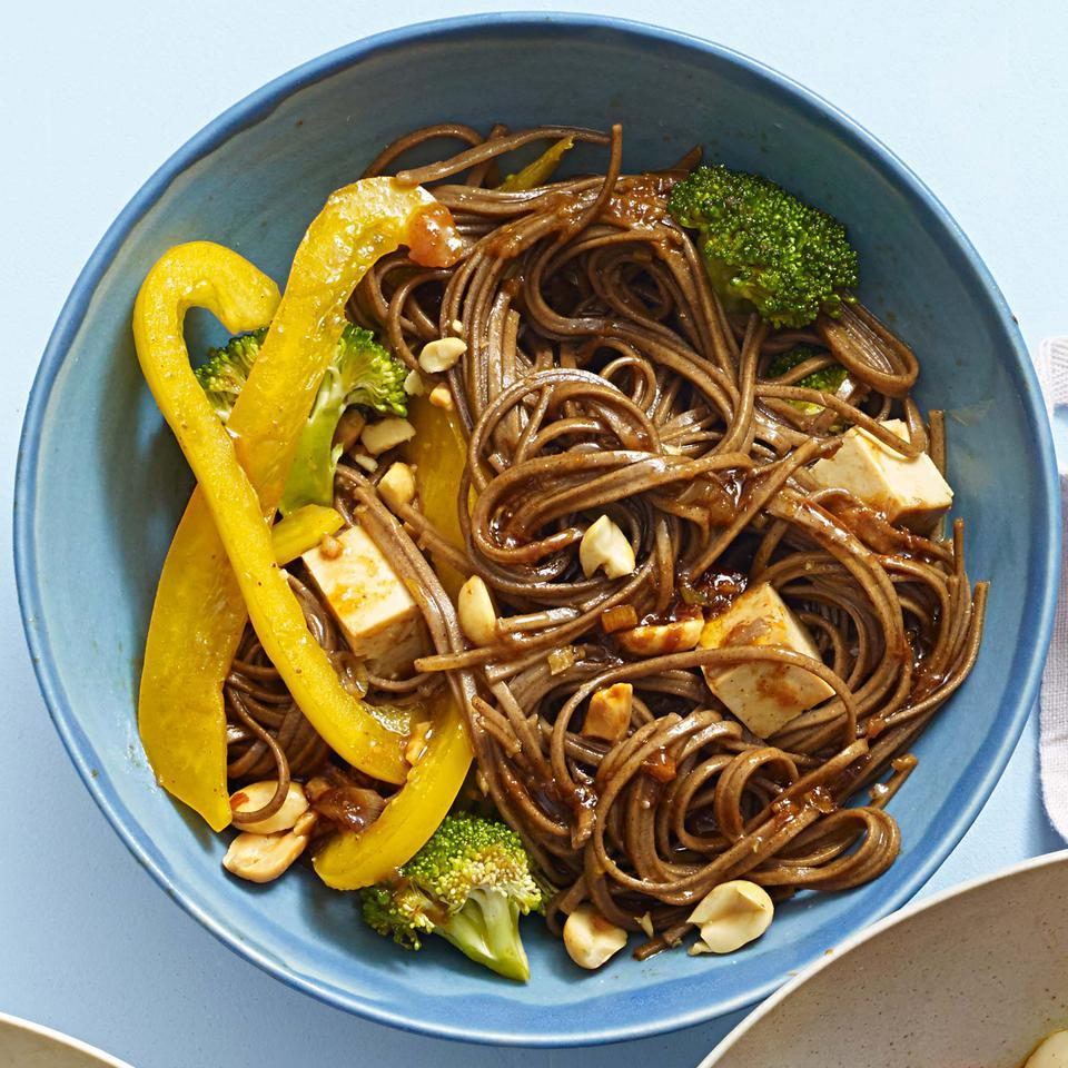 "Chinese hoisin sauce gives this healthy sesame noodle recipe just a touch of sweetness. Be sure to rinse the noodles until they're cold, then give them a good shake in the colander until they're well drained. Are you a spiralizing pro? Swap 5 cups of raw zucchini, carrot or other veggie ""noodles"" for the cooked pasta."