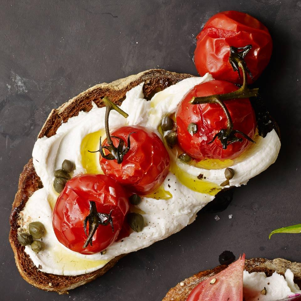 Roasted Cherry Tomato & Goat Cheese Tartines EatingWell Test Kitchen