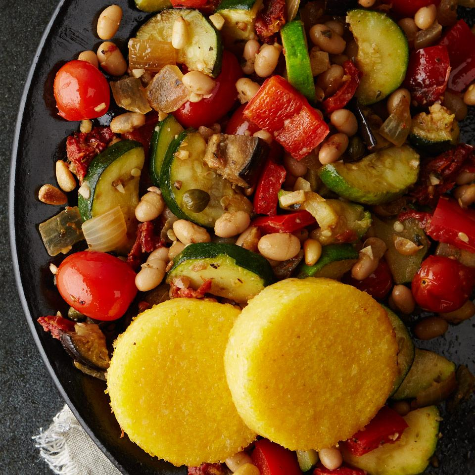 Tons of lightly cooked vegetables combine with white beans in this hearty vegetarian dinner recipe. It can also be served over bread, like bruschetta.