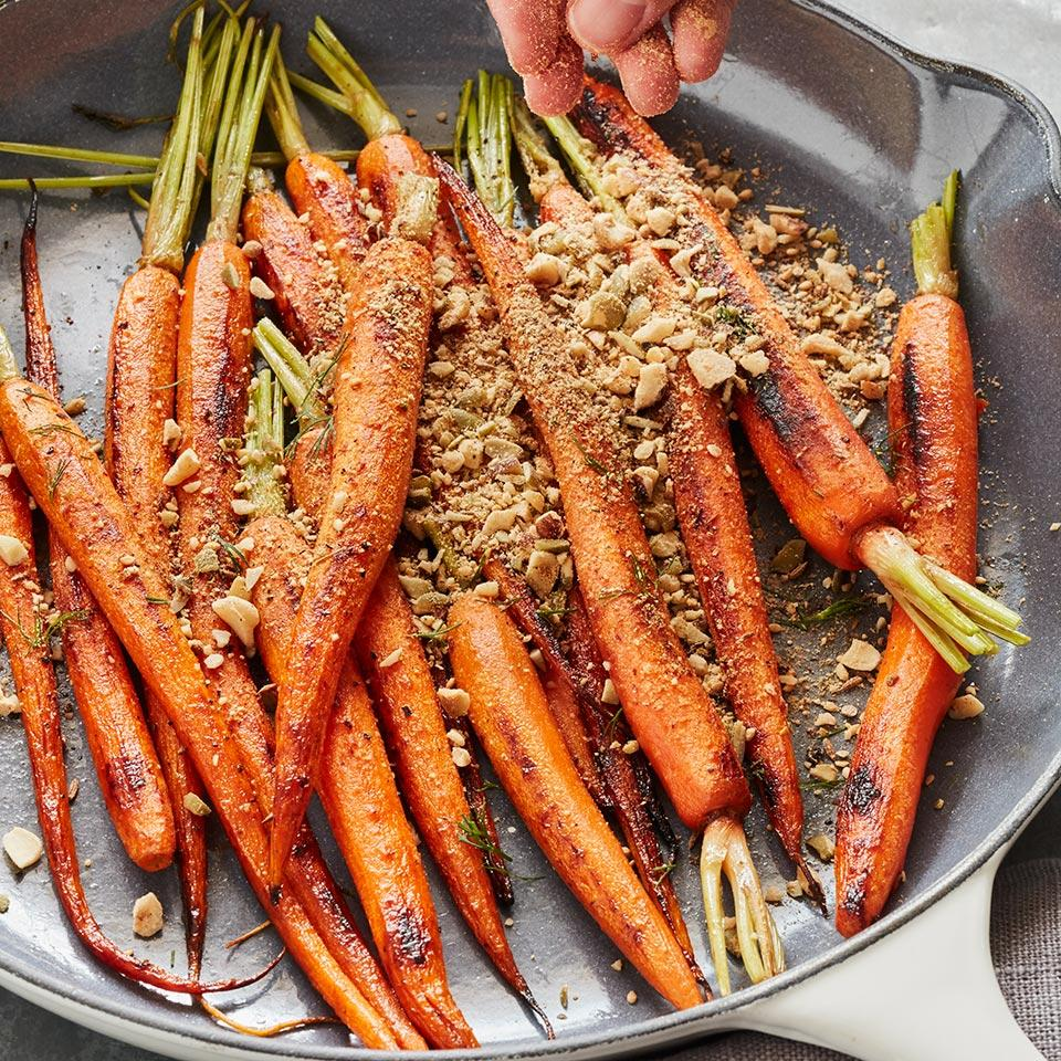 Pan-roasted carrots become an exotic winter side when topped with dukkah, an Egyptian spice blend, in this healthy vegetable recipe. Dukkah plays nicely with other vegetables too. Try it on steamed asparagus in the spring, grilled eggplant in summer and roasted romanesco or cauliflower steaks in the fall.
