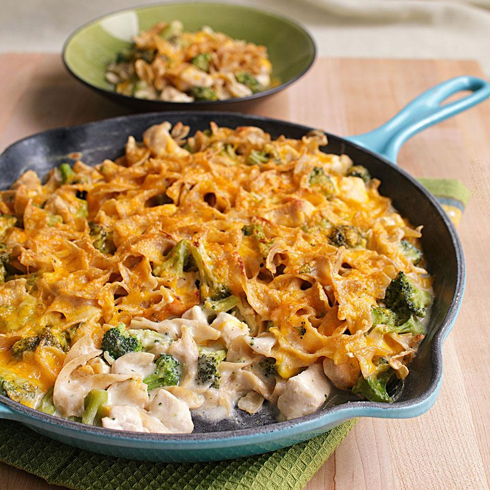 We trimmed 9 grams of fat and almost 100 calories in this makeover of cheesy chicken-and-broccoli casserole. All the raw ingredients are layered in a skillet, then simmered for a quick weeknight dinner.