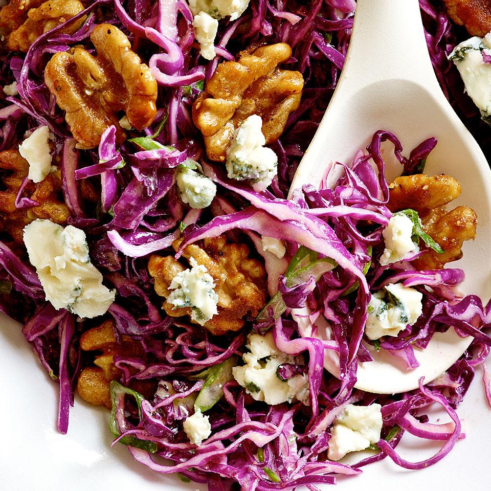 Serve this hearty salad recipe—combining red cabbage, blue cheese and glazed walnuts—as an accompaniment to roast pork or chicken. To slice the cabbage quickly, cut the head into wedges and slice in your food processor. A mandoline is also a great tool for the job.