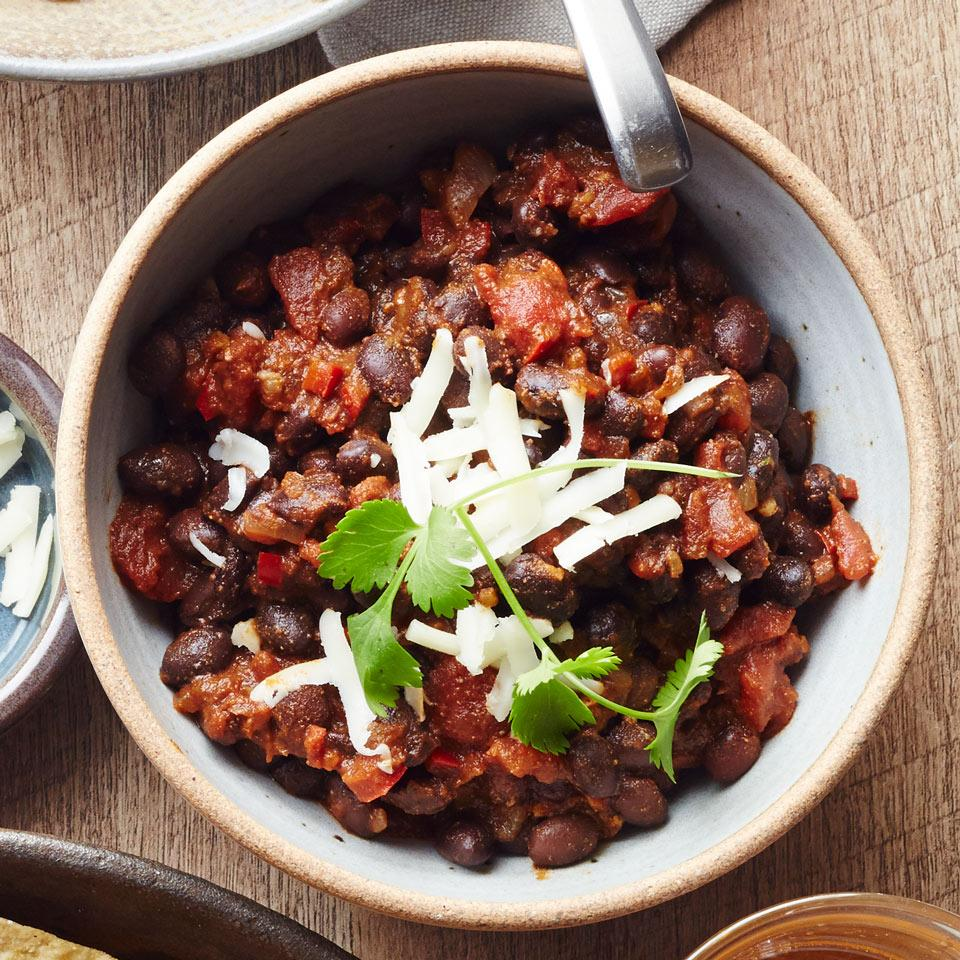 Canned beans and tomatoes make this quick vegetarian chili recipe ready to go in just 30 minutes. Serve over rice or couscous, or with tortilla chips for added crunch, and add extra toppings as you see fit—sliced scallions, chopped fresh cilantro, diced avocado and sliced jalapeños are all tasty choices.