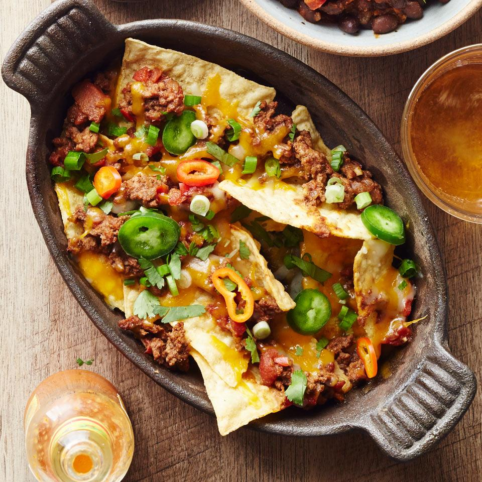 Make nachos a healthy dinner when you top them with an easy 30-minute chili. Serve this healthy recipe with sliced scallions, avocado, fresh tomatoes and sour cream, if desired.