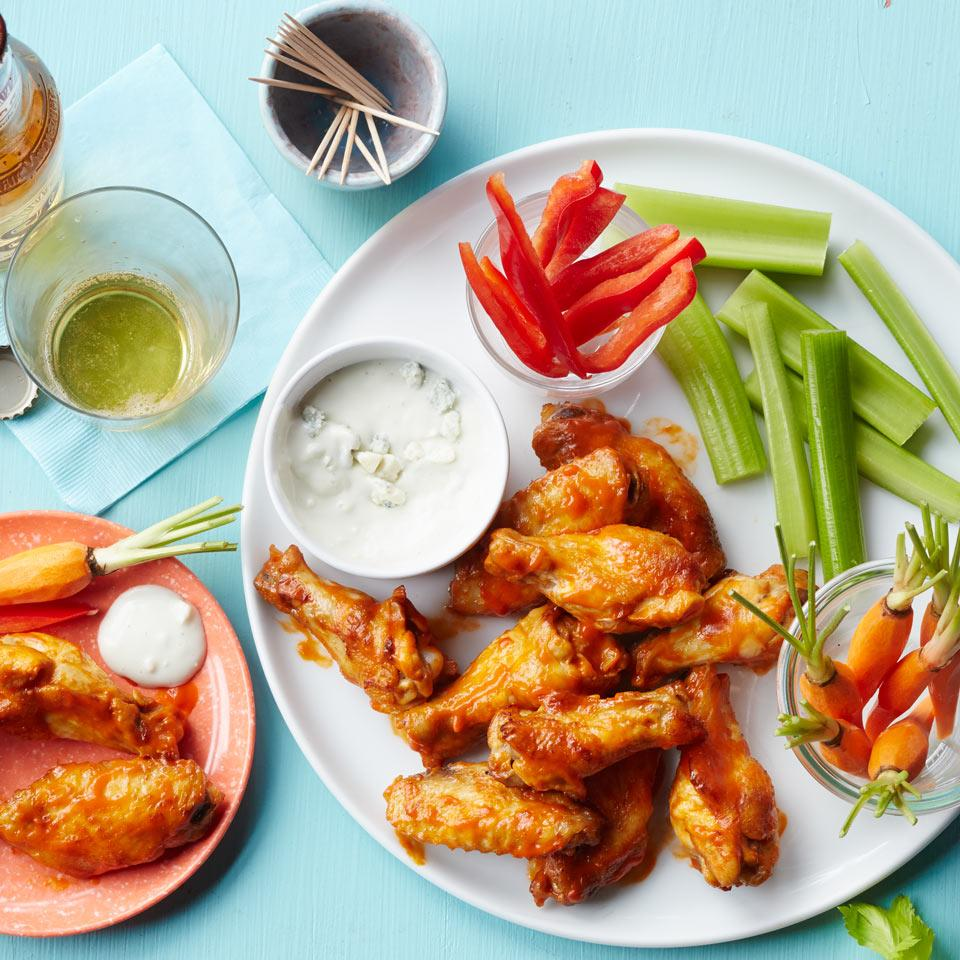 Make this baked Buffalo chicken wing recipe at home to save 138 calories and a whopping 598 milligrams of sodium compared to the same number of deep-fried wings. If your market sells its chicken wings whole, you'll want to separate each into a wingette and a drumette so they cook evenly. They're easy to split apart with a sharp knife. Serve with carrot sticks, celery and ranch (or blue cheese) dressing.