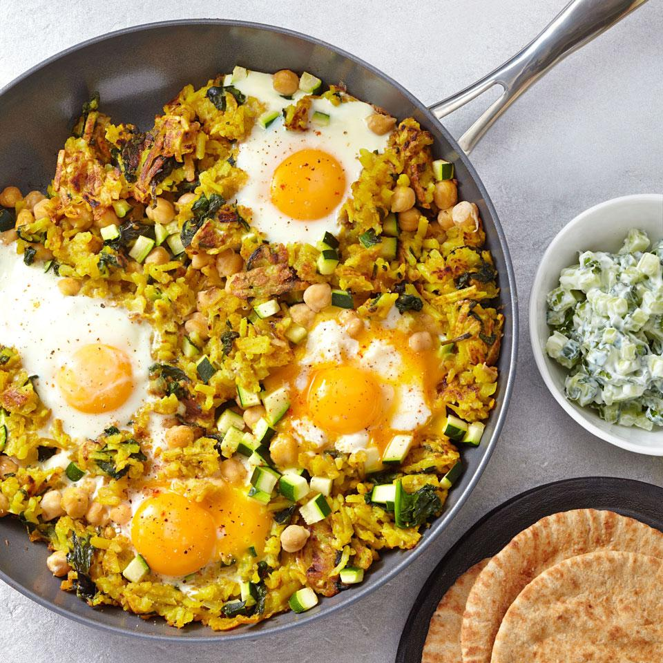 The eggs cook right on top of this chickpea and potato hash—cook them a few extra minutes if you prefer hard-set eggs. Serve with warm pita bread and a cucumber salad with mint and yogurt.