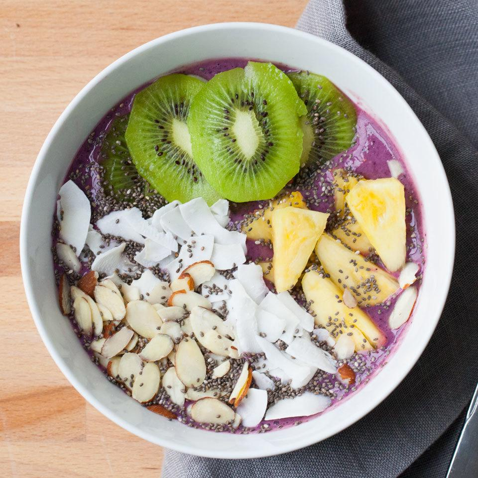 Eat this thick and creamy smoothie bowl with a spoon! Banana and frozen berries whip together with a little nut milk for a toppable vegan breakfast. We use fruit, nuts and seeds for topping, but feel free to experiment with whatever you like.