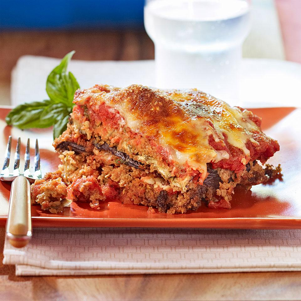 Eggplant Parmesan doesn't have to include layers of deep-fried eggplant and mountains of cheese. This healthy eggplant Parmesan recipe has is satisfying without piling on the calories and fat. Don't skip the step of salting the eggplant, especially if you want to freeze one of the casseroles. Salting helps to draw out extra moisture so the eggplant holds up better in the freezer. Serve with a salad of bitter greens tossed with a red-wine vinaigrette. This recipe makes enough for two 8-by-8-inch casseroles (four servings each)—have one for dinner tonight and freeze the other for a night when you don't have time to make dinner.