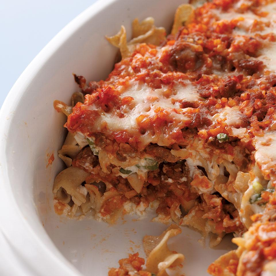 The EatingWell Test Kitchen takes lean ground beef and combines it with whole-grain bulgur, egg noodles and a creamy tomato sauce in a baked casserole topped with Cheddar. With less fat and calories than the original skillet meal, this dish is sure to become a new family favorite.