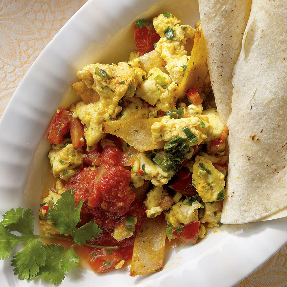 Crumbled soft tofu is often used to make satisfying, egg-free scrambles so it's a natural for a vegan interpretation of migas, a traditional Tex-Mex dish made with eggs and strips of corn tortillas. In this version, fresh chiles, chipotle and cilantro balance the neutrality of the tofu. Serve with a side of black beans.