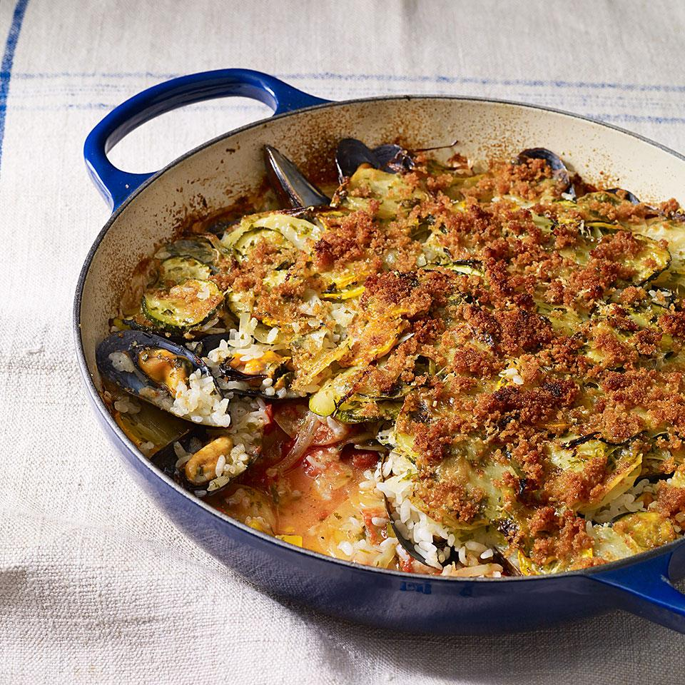 In this Italian paella recipe, potatoes and other vegetables are layered with mussels and rice and baked in a casserole dish. Be sure to cover the rice completely with vegetables to ensure it cooks properly.