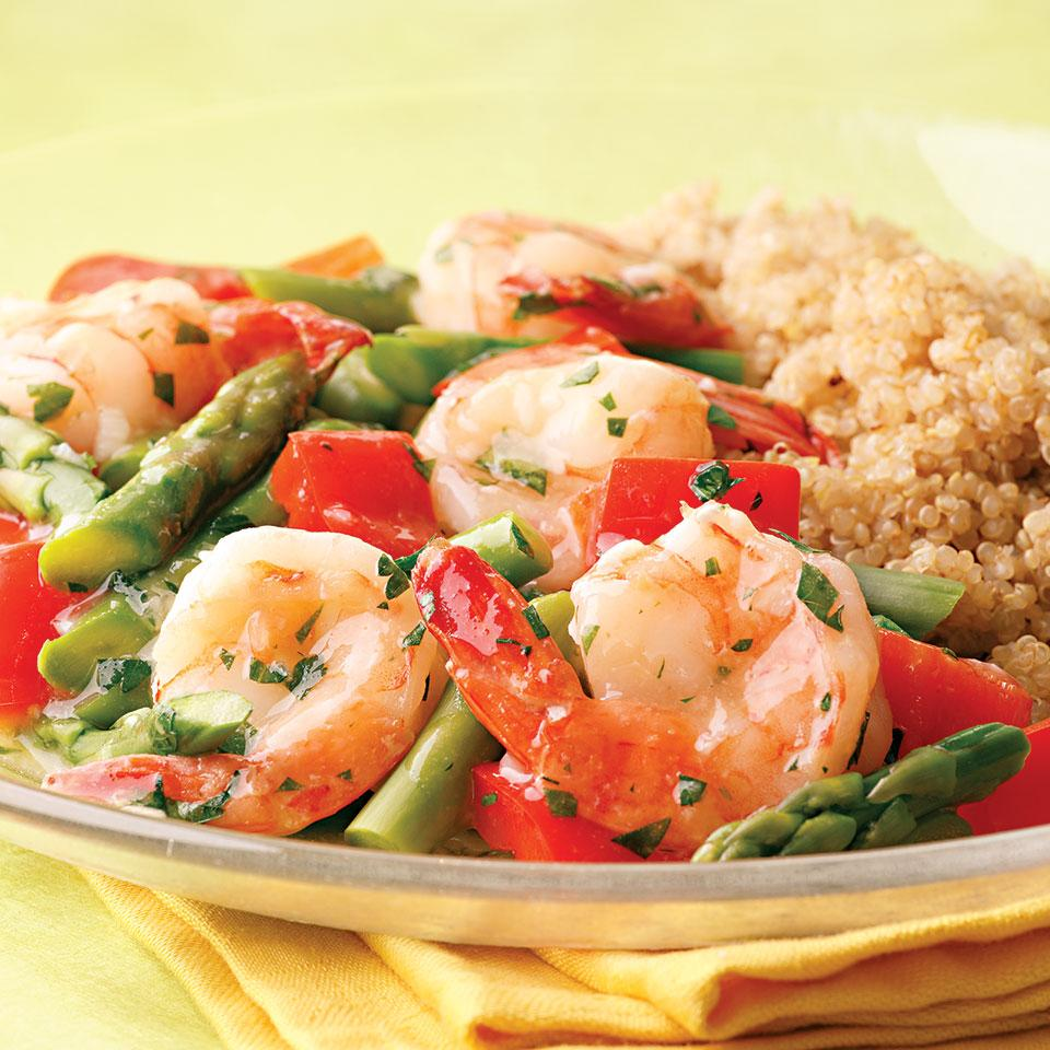 Here's a healthy twist on shrimp scampi. We left out the butter and loaded the dish up with red peppers and asparagus for a refreshing spring meal. Serve with quinoa.