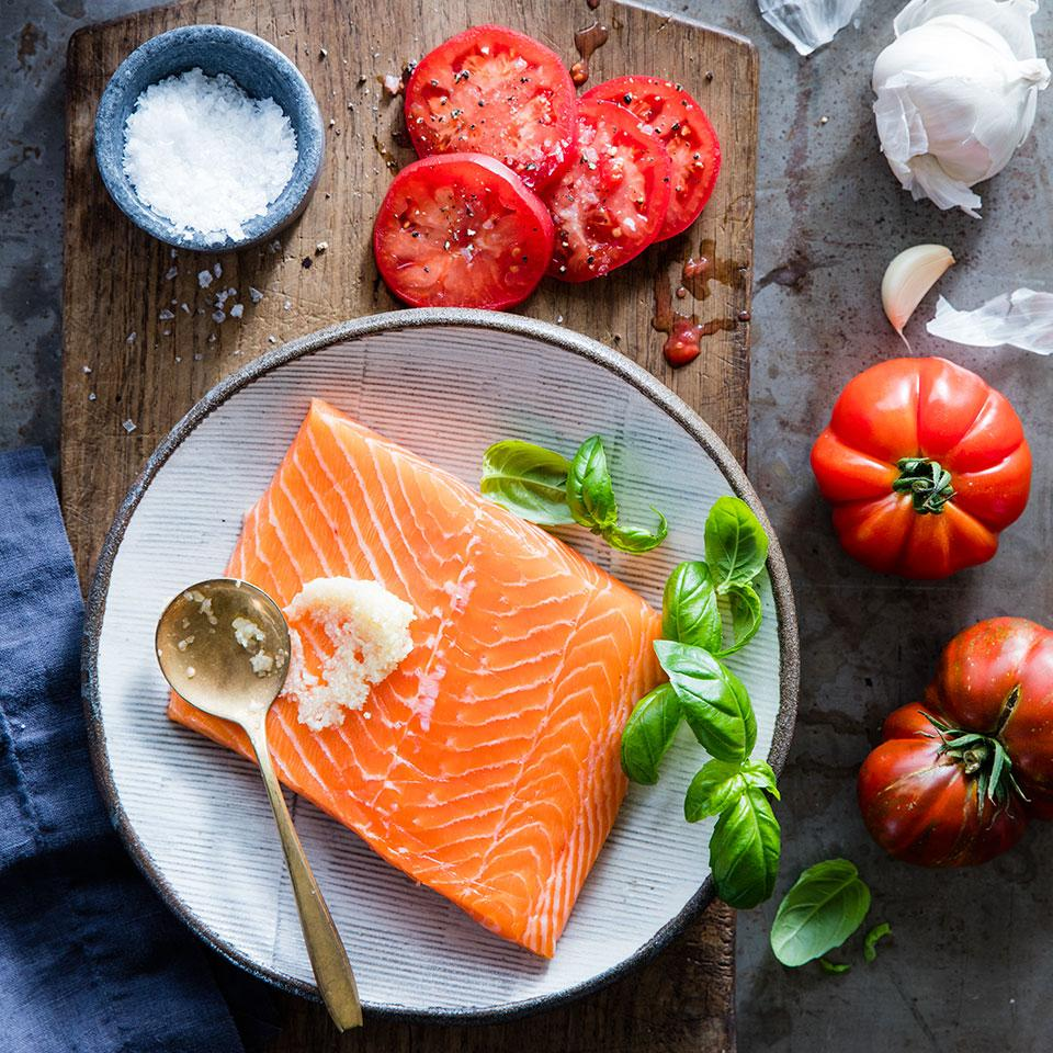 This recipe is so beautiful and yet so simple to prepare—it's perfect for entertaining. You just spread a side of salmon with minced garlic, sprinkle with fresh basil, then layer sliced tomatoes on top. Put it on the grill for 10 minutes and you're done!