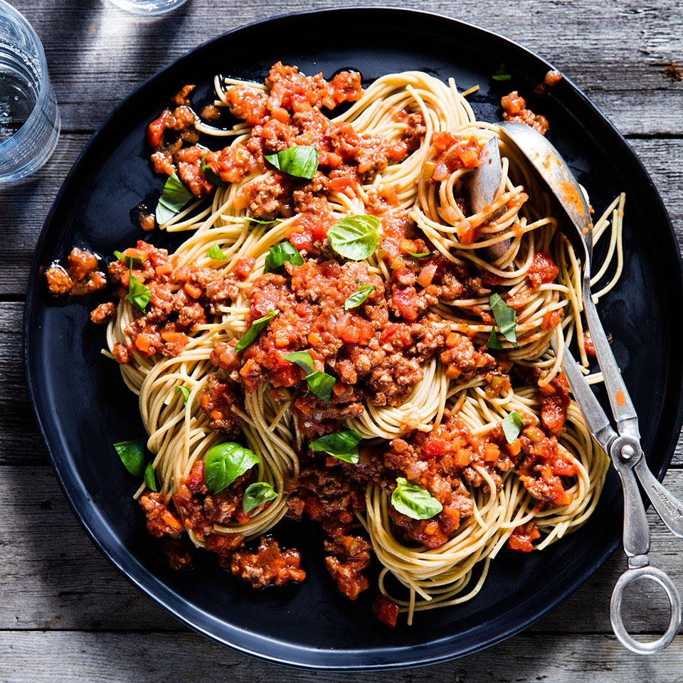 Instead of opening a jar of sauce, try this easy spaghetti with meat sauce on a weeknight. Serve with steamed broccoli and garlic bread. The recipe makes enough for 8 servings. If you're serving only four for dinner, cook 8 ounces of spaghetti and freeze the leftover sauce.