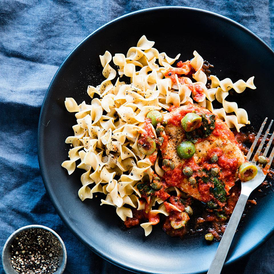 This saucy one-skillet chicken dish is full of tomatoes, spinach, olives and capers. Try Kalamata olives in place of the green Sicilians or a combination of both. Serve over whole-wheat egg noodles with a mixed green salad on the side.