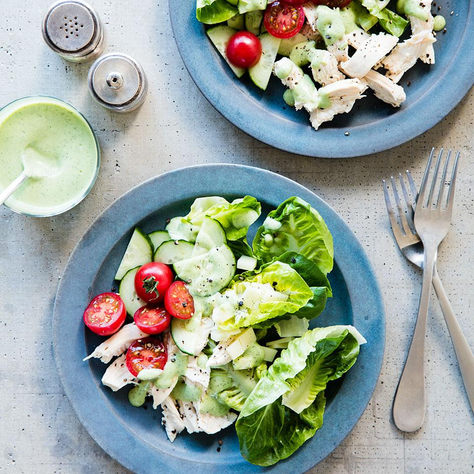 In this cucumber, tomato, Swiss and chicken salad recipe, a healthy green goddess dressing is made from avocado, buttermilk and herbs. Any extra dressing is delicious served over grilled chicken or flaky white fish, such as cod or flounder.