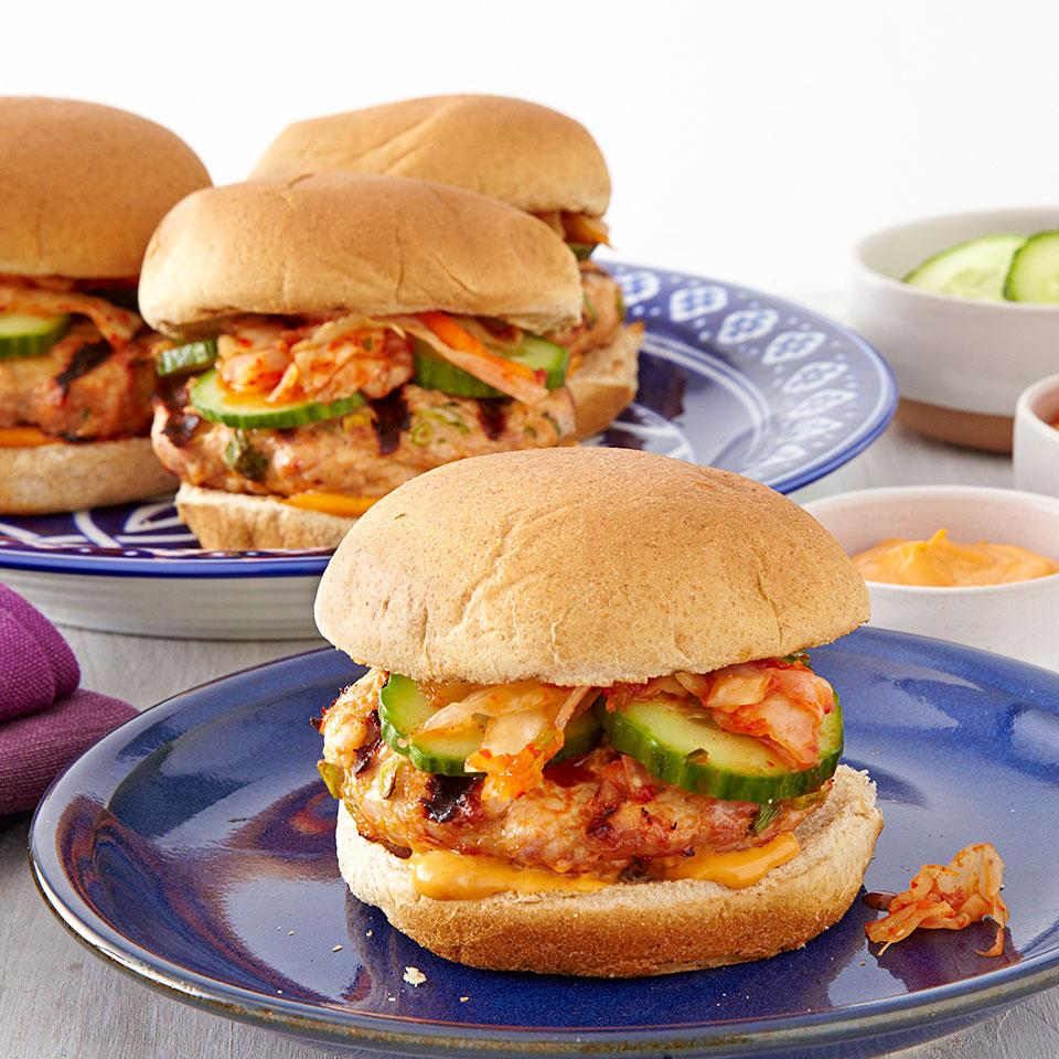 Korean chile paste (also known as gochujang) blended into the ground turkey makes this turkey burger recipe incredibly moist and flavorful. Top these healthy turkey burgers with kimchi—a fermented mixture of cabbage and other vegetables—which can be found near other refrigerated Asian ingredients or near sauerkraut or pickles in well-stocked supermarkets or natural-foods stores.