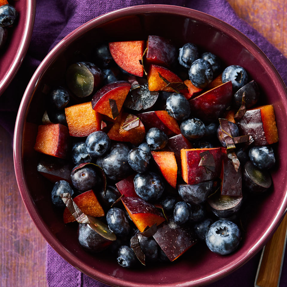 Serve this refreshing fruit salad featuring juicy plums, grapes and berries on its own or with other colorblock fruit salads (like red, green and orange) for a fun, crowd-pleasing rainbow side dish.