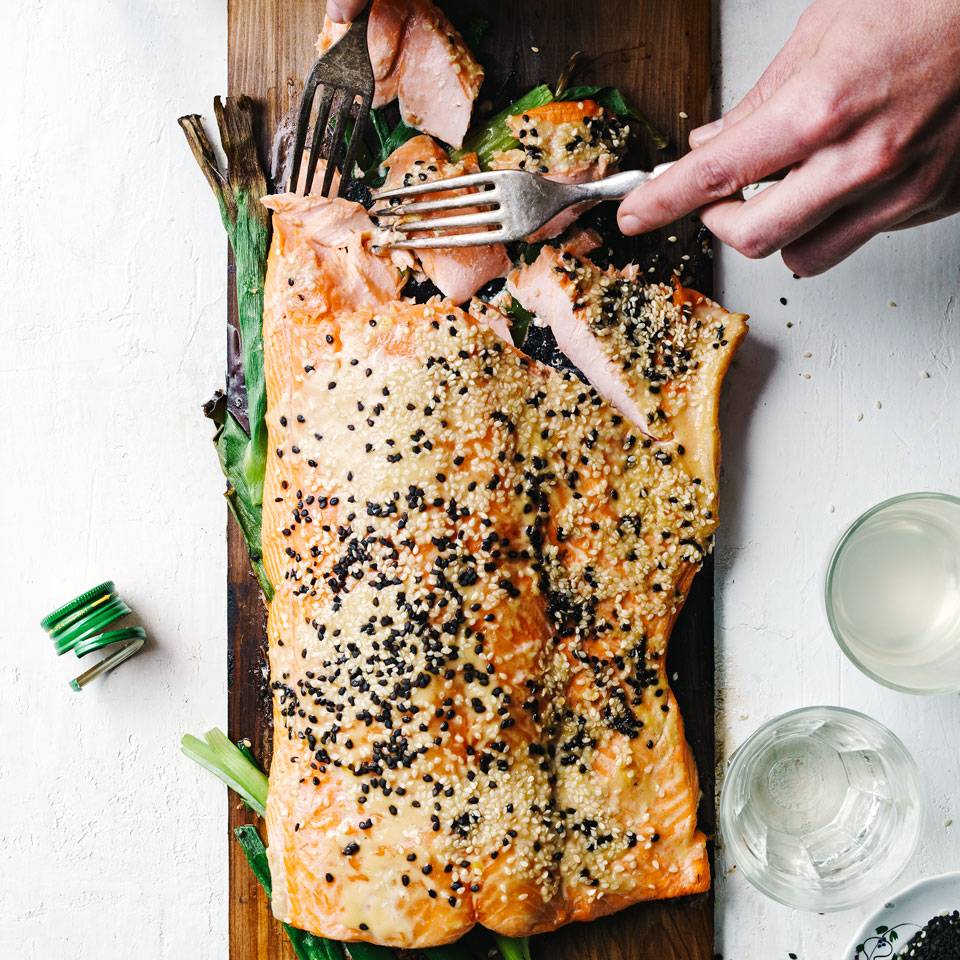Besides adding smoky flavor, cooking salmon on a plank eliminates the triple pitfalls of grilling fish—drying out, sticking to the grate or breaking when you attempt to turn it. For this healthy grilled salmon recipe, the sweet-salty flavor of the miso-maple glaze counterpoints the buttery richness of the fish.