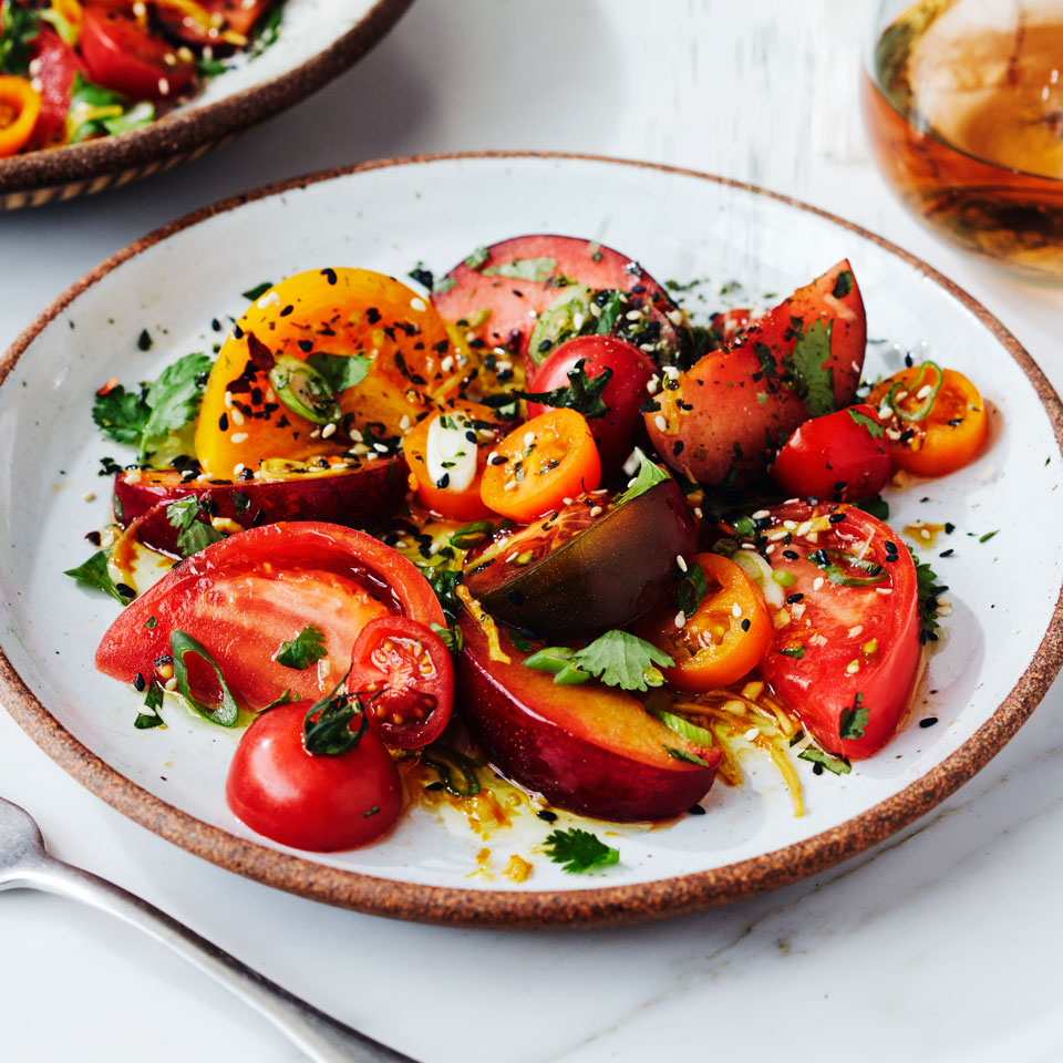 Most of this savory fruit-and-tomato salad recipe can be prepared in advance—just mix the tomatoes with the dressing right before serving. For the most stunning presentation, use a mix of colorful heirloom tomatoes.