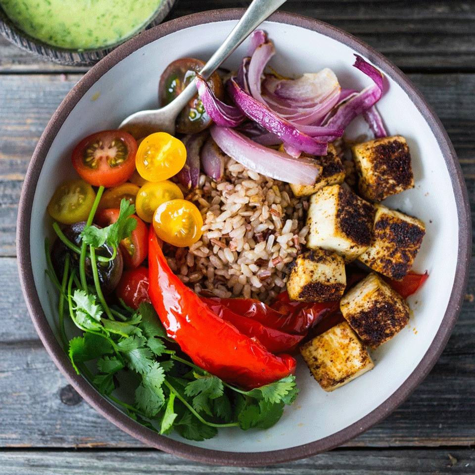 Crispy tofu lends protein to this burrito bowl-inspired veggie-packed grain bowl that's perfect for a quick and easy dinner or packable lunch for work.